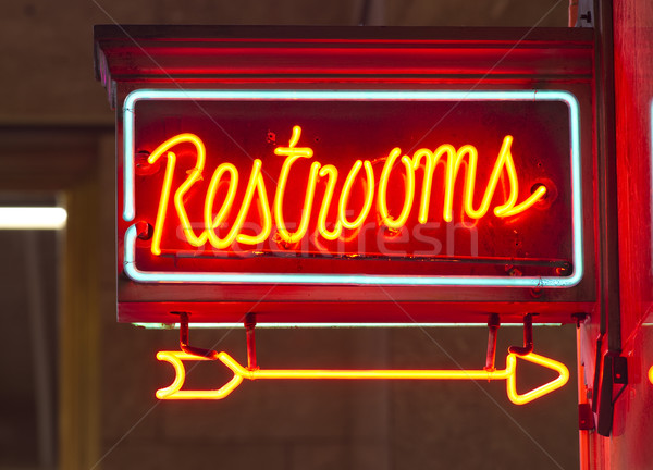 Red Neon Restrooms Sign Indoor Signage Arrow Pointing Stock photo © cboswell