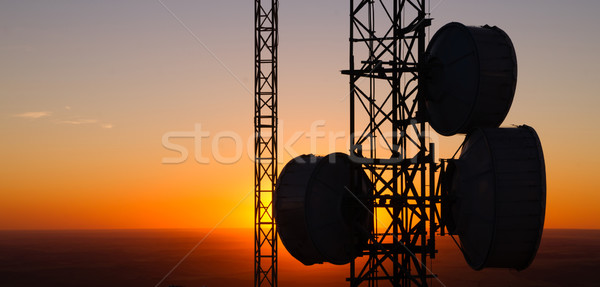 Cellular Radio Wave Communication Towers Evening Sunset Horizon Stock photo © cboswell