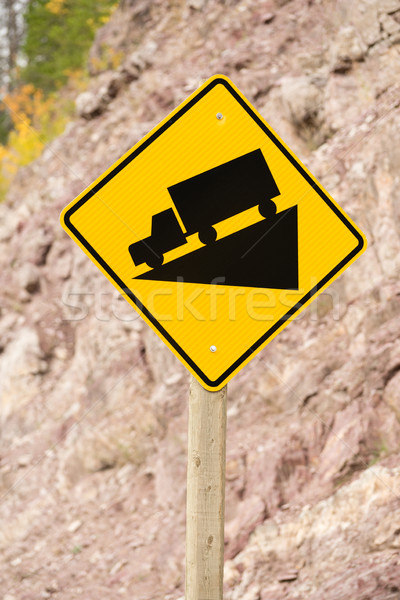 Yellow Square Road Sign Warning Steep Decline Ahead Stock photo © cboswell