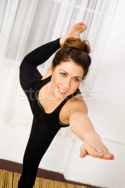 Young Attractive Woman Balances Standing Pose Yoga Practice Danc Stock photo © cboswell