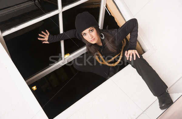 Female Intruder Sneaks in Thruogh Open Window Thief Prowler Stock photo © cboswell
