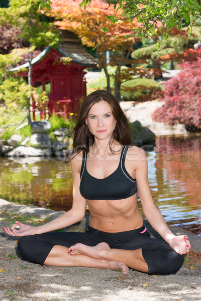 Happy Healthy Attractive Woman Practices Yoga Relaxation Technique Stock photo © cboswell