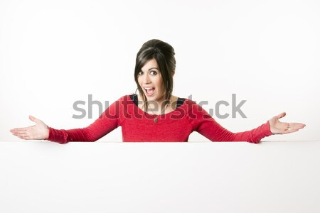 Female Presenter Stands Above Blank White Board Smiling Woman Stock photo © cboswell