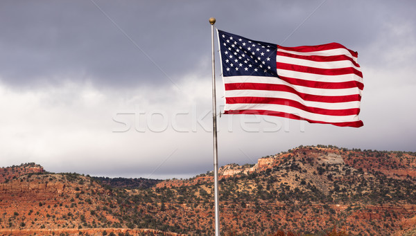 Wind Waving Bright Patriotic American Flag Stars and Stripes Stock photo © cboswell