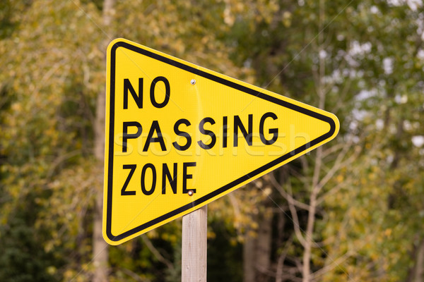 Yellow Triangle Road Sign Warning No Passing Zone Stock photo © cboswell