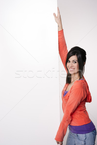 Female Presenter Stands At Blank White Board Smiling Woman Stock photo © cboswell