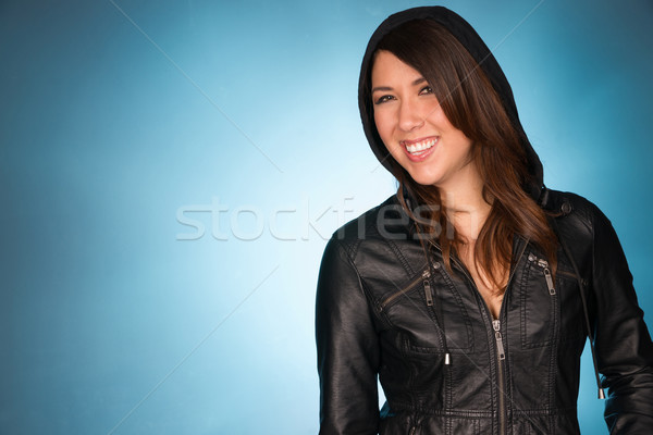 Hip Smiling Young Adult Woman Wearing Leather Jacket Hooded Swea Stock photo © cboswell