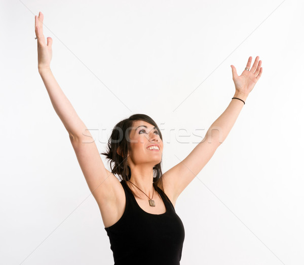 Pretty Brunette Woman Holds Arms Outstretched Jubilant Looking Up Stock photo © cboswell