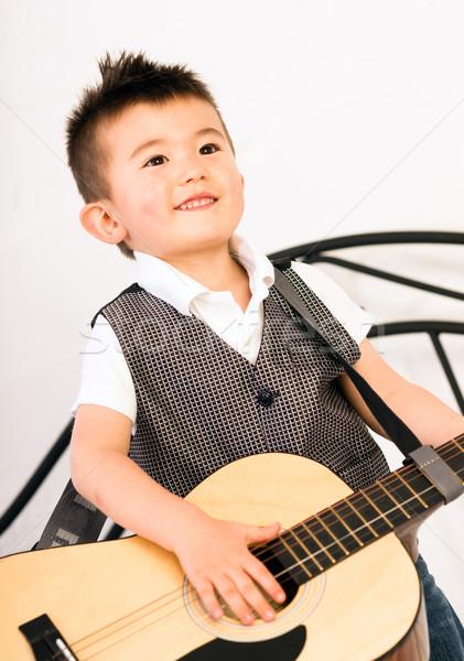 полный размер гитаре зубов играет Сток-фото © cboswell