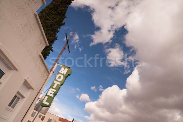 Neon Motel Sign Clear Blue Sky White Billowing Clouds Stock photo © cboswell