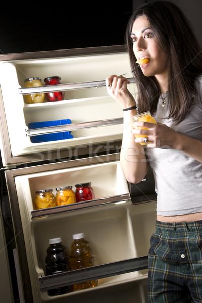 冷蔵庫 眠い 女性 冷蔵庫 ドア ストックフォト © cboswell