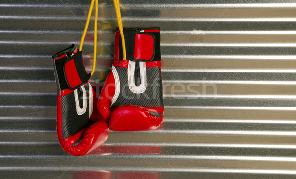 Red Boxing Gloves Hanging on a Hook Stock photo © cboswell