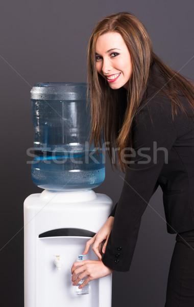 Pretty Brunette Woman Office Staff Water Cooler Workplace Drink Stock photo © cboswell