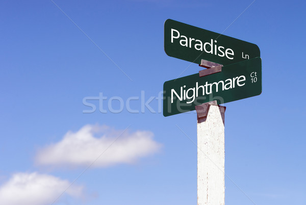 Paradise Nightmare Signs Crossroads Street Avenue Sign Blue Skie Stock photo © cboswell