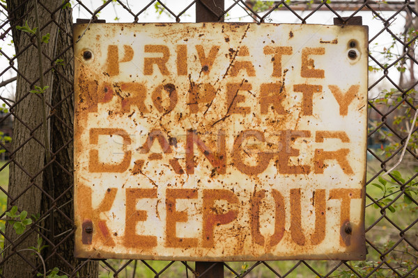 Private Property Danger Keep Out Sign Rusted Fence Stock photo © cboswell