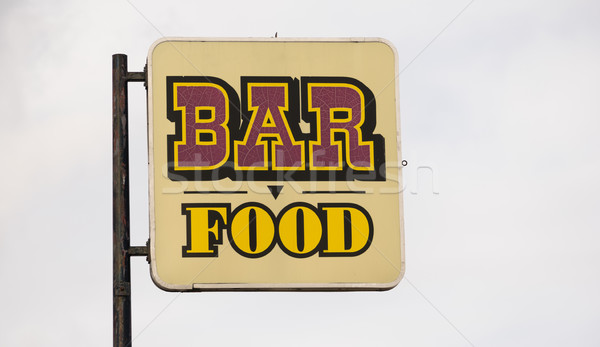 Rusted Metal Faded Sign Advertising Bar Food Stock photo © cboswell