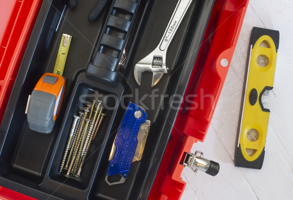 Orange Tool Box Wrench Measuring Tape and Level Stock photo © cboswell