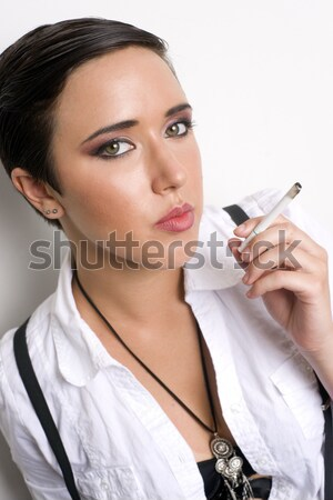 Young Androgynous Person Stands Smoking Cigarette Battling Addic Stock photo © cboswell
