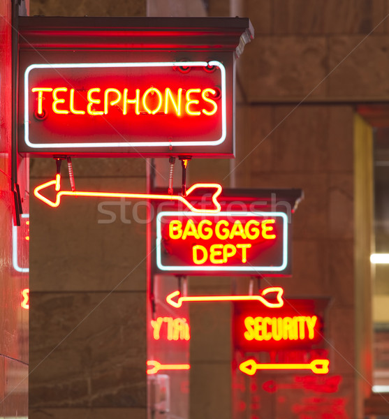 Red Neon Sign Indoor Depot Signage Arrow Points Baggage Telephon Stock photo © cboswell