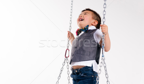 Happy Young Boy Plays Swing Suspended Moving Laughing Child Play Stock photo © cboswell