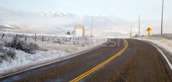 Fresh Snow Blankets Hillside Rural Country Scene Two Lane Road Stock photo © cboswell