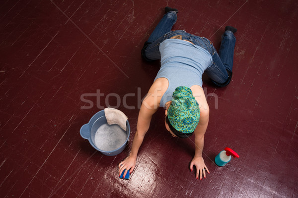Adorable Housewife Maid Doing Cleaning Chores Scrubbing Floor  Stock photo © cboswell