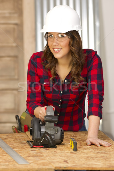 Woman Works on a Bench Cutting a Board Stock photo © cboswell