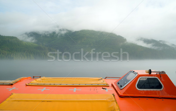 Orange Lifeboat Inside Passage Sea Ocean Liner Cruise Stock photo © cboswell