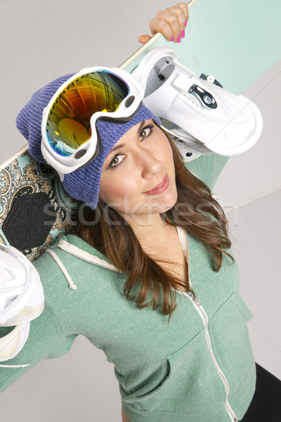 Snowboard and Fun Loving Female in Teal Stock photo © cboswell