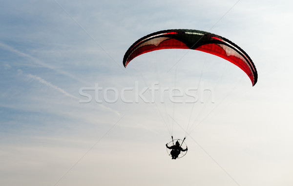 One Man Rides Flies Ultralight Flying Through Blue Sky Stock photo © cboswell