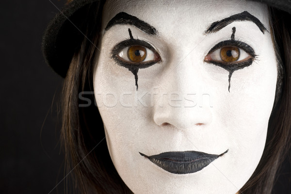 Stock photo: Female in White Face Playing a Clown or Mime