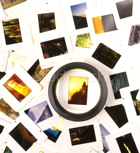 Mounted Slide Film and Loupe Sitting on The Lightbox Stock photo © cboswell