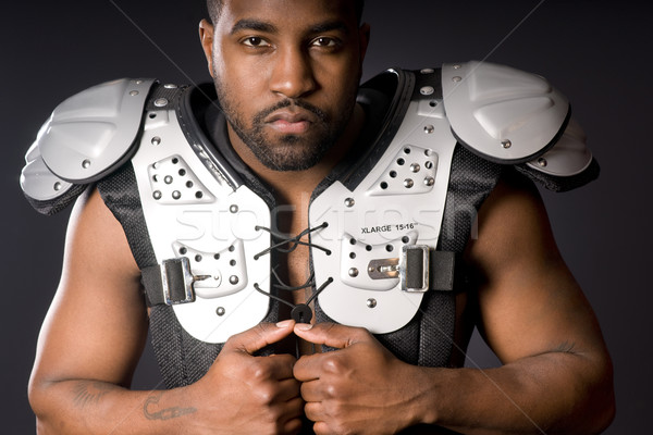 Football Player in Shoulder Pads Stock photo © cboswell