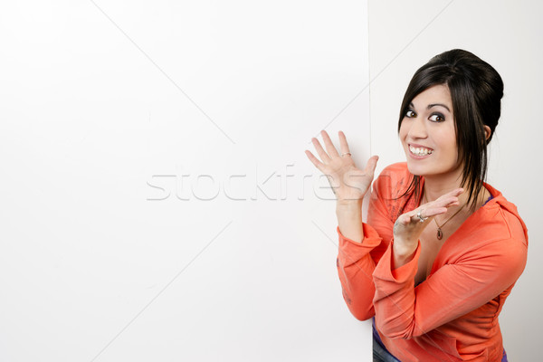 Female Presenter Stands Blank White Board Smiling Excited Woman Stock photo © cboswell