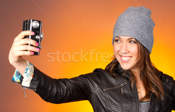 Hip Woman Snaps a Self Portrait with Vintage Camera Stock photo © cboswell
