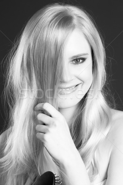 Hermosa sonriendo rubio mujer pelo diversión Foto stock © cboswell