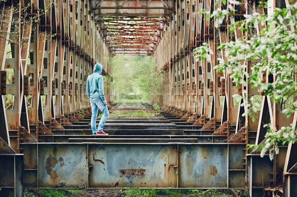 Szomorú férfi elhagyatott híd sétál rozsdás Stock fotó © Chalabala