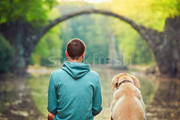Dalgın adam oturma köpek genç gölet Stok fotoğraf © Chalabala