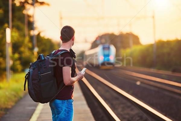 Gezgin gün batımı geç tren istasyonu genç sırt çantası Stok fotoğraf © Chalabala