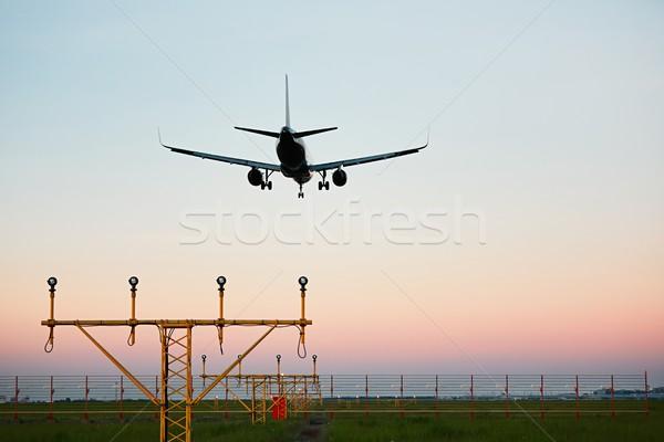 Repülőgép leszállás naplemente repülőtér színes utazás Stock fotó © Chalabala
