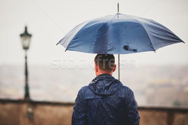Adam yağmurlu gün genç mavi Stok fotoğraf © Chalabala