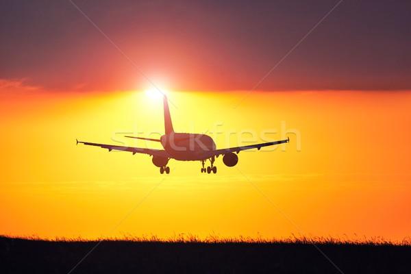 Uçak gün batımı iniş havaalanı şaşırtıcı gökyüzü Stok fotoğraf © Chalabala