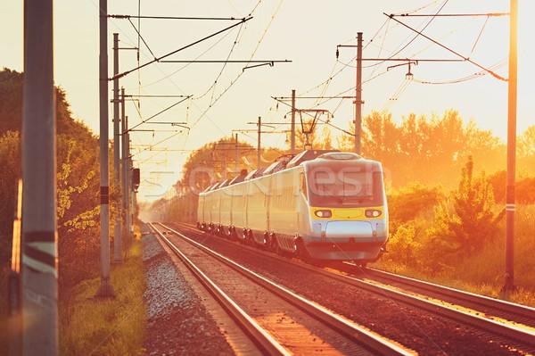 Demiryolu şaşırtıcı gün batımı modern tren Stok fotoğraf © Chalabala
