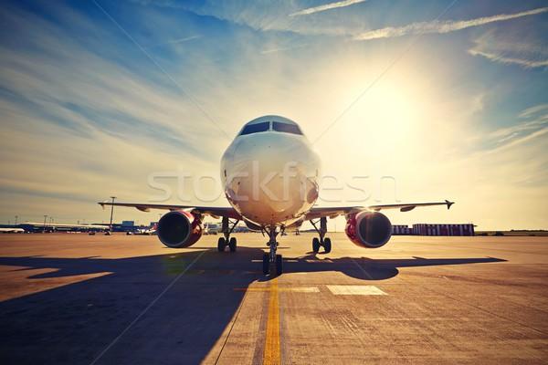 самолет Восход небе здании Сток-фото © Chalabala