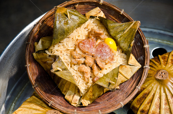 Rice wrapped in lotus leaf. Stock photo © chatchai