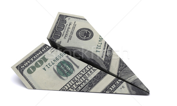 paper airplane from the dollars on a white background Stock photo © cherezoff