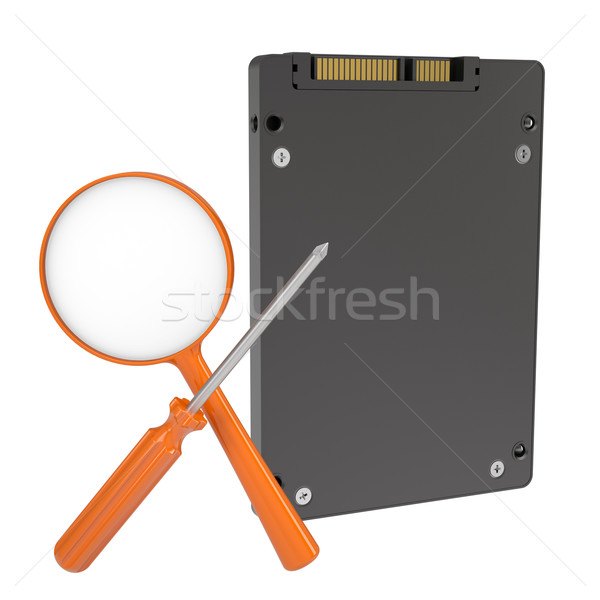 Solid-state drive, magnifier and screwdriver Stock photo © cherezoff