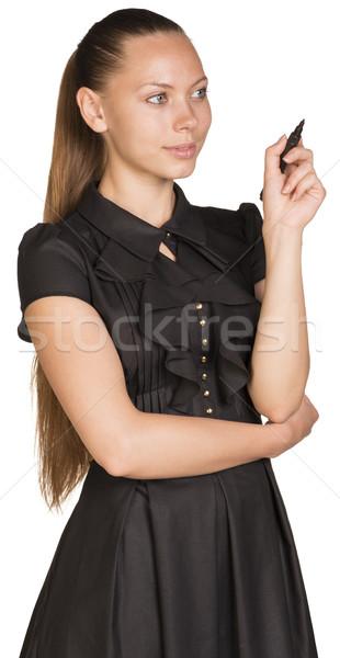 Jonge zakenvrouw tekening denkbeeldig oppervlak geïsoleerd Stockfoto © cherezoff