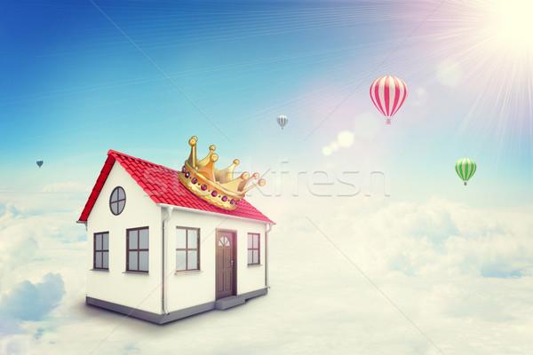 A casa branca vermelho telhado coroa nuvem sol Foto stock © cherezoff
