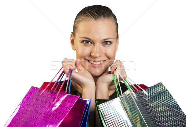 Woman with teeth smile handing bags. Closed up Stock photo © cherezoff